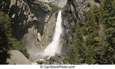 Yosemite Falls - Spring melt water cascades from the lower...