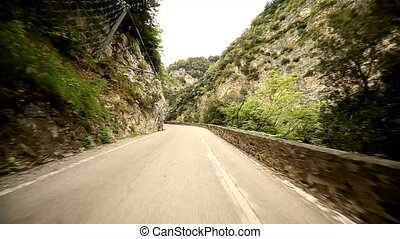POV Car in Canyon Road - road SP 38 at the lake garda in...