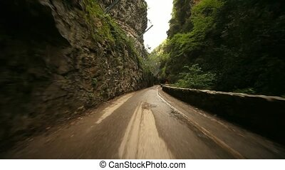 POV Car in Canyon Road - video footage of the road SP 38 at...