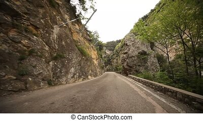 POV Country Road - road SP 38 at the lake garda in italy,...