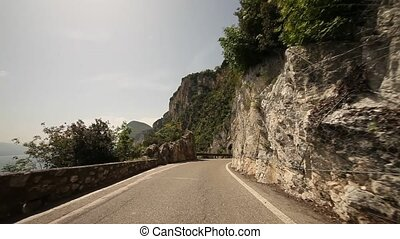 POV at lake garda, Italy - road SP 38 at the lake garda in...