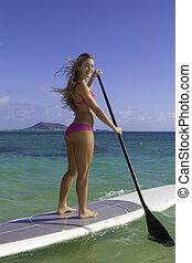 girl on stand up paddle board - beautiful blonde in bikini...