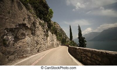 Driving on street at lake garda, POV - driving at the lake...