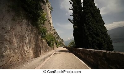 Driving at lake garda POV - driving at the lake garda in...
