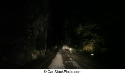 Driving in Canyon at night - road SP 38 at the lake garda in...