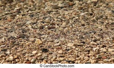 Breakers at lake - waves at a lake with pebble stones