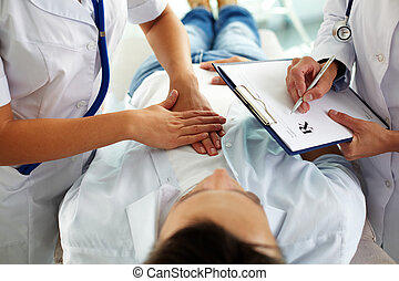 Medical treatment - Close-up of two doctors during medical...