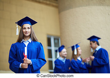 Smart student - Friendly students in graduation gowns...