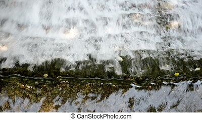 water cascade river - closeup of river stream water flow...