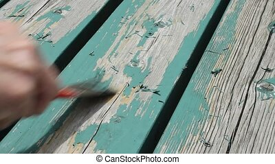 scraping paint - scraping old wood in preparation for new...