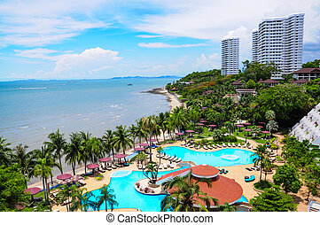 Swimming pools and bar at the beach of luxury hotel, Pattaya,
