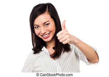 Smiling young woman showing thumbs up - Keep up the great...