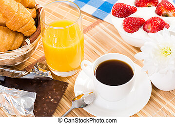 continental breakfast: coffee, strawberry with cream,...