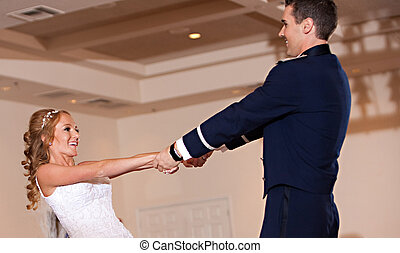 Newlywed Couple First Dance - A newlywed couple dances on...