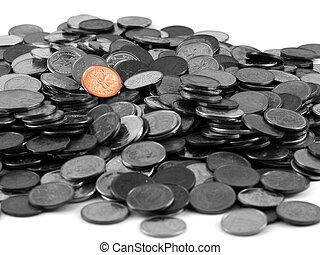 Penny Standing Out - A pile of mostly Canadian coins with a...
