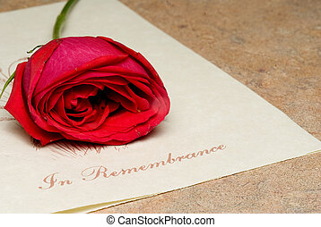 In Remembrance - A funeral bulletin with a single red rose.