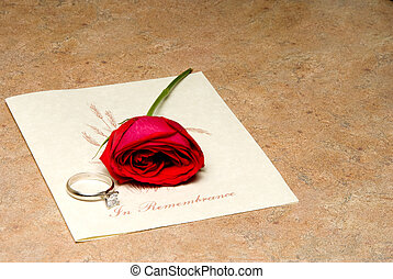 In Remembrance - A funeral program with a rose and wedding...