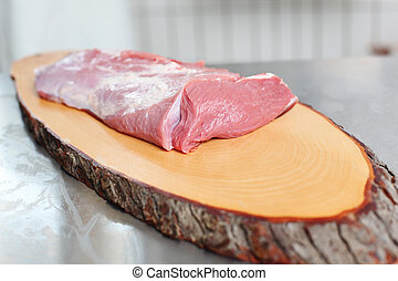 Fresh meat over a wooden meat board - Fresh meat on display...