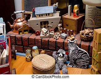 Antique Toys - A collection of antique toys on a fireplace...