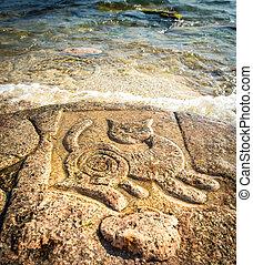 Rock carvings on the beach (cat) near Sevastopol (Crimea),...