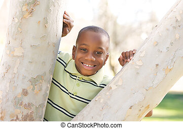 Young Boy Having Fun In The Park