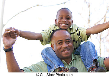 Man and Young Boy Having Fun - Man and Child Having fun in...
