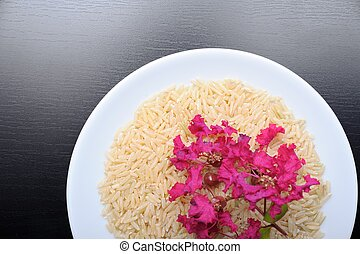Brown rice - closeup brown rice on plate, decoration with...