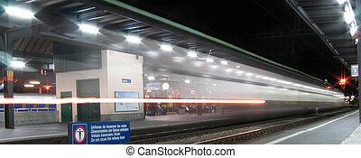 Train passing Geneva station - The lights of a fast train...