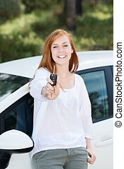 Laughing woman with a car key
