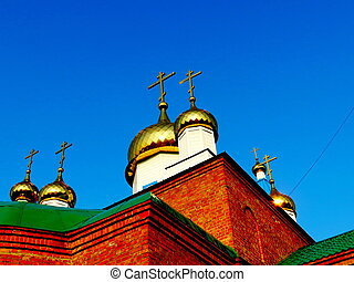 Rural church - Domes of rural church are shone from sunshine...