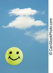 Tennis ball smiley face represents summer fun