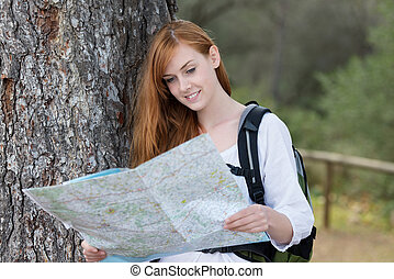 Woman backpacker with a map - Beautiful active young woman...