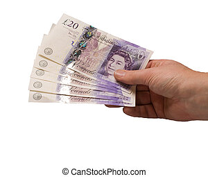 sterling cash - british pounds being held in a hand isolated...