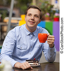 young man in the cafe