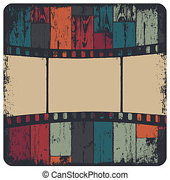 Film strip in grunge frame on colorful seamless wooden...
