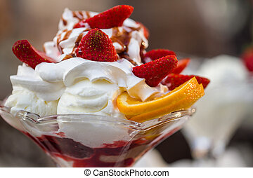 Delicious vanilla sundae with strawberry shoot with short...
