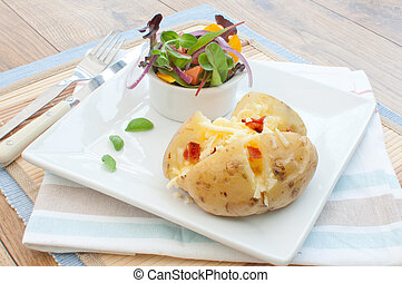 Baked jacket potato - Melting cheese and bacon pieces with...