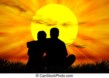 Lovers at sunset - Lovers on the grass in front of the...