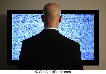 Watching television - A man watching a blank or static...