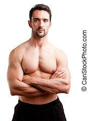 Fit Man Standing With Arms Crossed - Fit man standing...