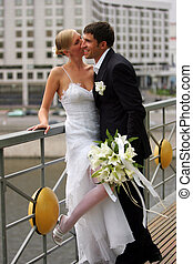 Newlywed couple in love urban scene