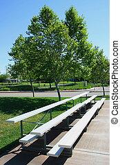 Bleachers - Empty bleachers on a stadium in a park.