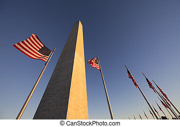 Washington Monument and US Flag - Washington Monument at...