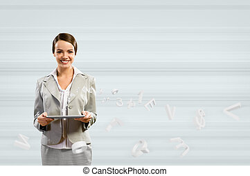 attractive business woman holding a tablet