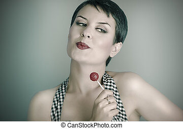 20s woman with lolly pop, pin up style