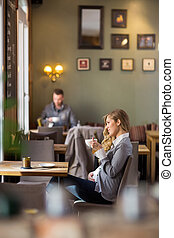 Pregnant Woman Having Coffee While Looking Away - Side view...