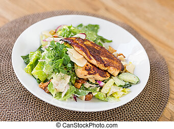 Chicken Caesar Salad - Closeup of chicken caesar salad with...