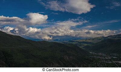 Mountainous landscape panorama view with bold white clouds...