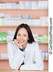 relaxed young woman working in pharmacy