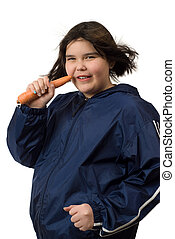 Healthy Lifestyle - A young girl eating a carrot while...
